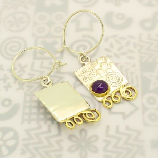 Matching small silver earrings